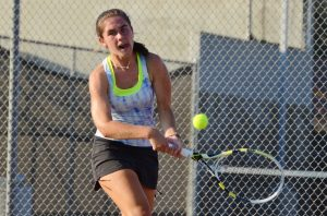 Photo by Nick Baker Clovis North tennis star Elizabeth Schulz hits a return during her TRAC singles tennis finals upset victory over Clovis West's Janie Ellis. Schulz, a junior, won 6-3, 2-6, 7-6 to capture the title in a grueling finals match.