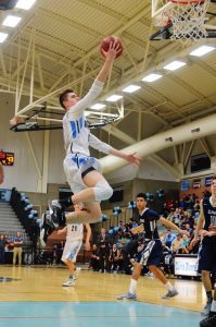 Photo by Nick Baker Ben Avera, a junior from Clovis North, flies in for an uncontested two points in the Broncos 81-64 victory over Clovis East. The win moved the Broncos into a tie for third place at 2-1 in league.